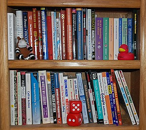 bookcase of books for entrepreneurs